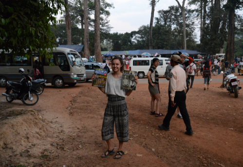 Kayla and crowds clamoring to catch the sunset at Angkor Wat