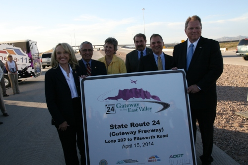 Officials celebrate the impending completion of State Route 24. From left: Jan Brewer, governor of Arizona; Alberto Gutier, director of Governor's Office of Highway Safety; Jane Morris, executive director of Phoenix-Mesa Gateway Airport Authority; Robert Halliday, director of Arizona Department of Public Safety; John Halikowski, director of Arizona Department of Transportation; Scott Smith, mayor of Mesa